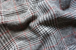 Rippled red and grey Glen check woolen fabric