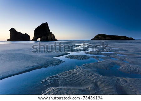 Rippled Sand and rock formations at Wharariki Beach, Nelson, North Island, New Zealand