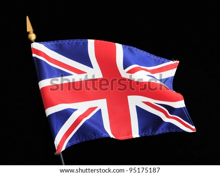 Ripples in Great Britain British Flag on Pole isolated on black background