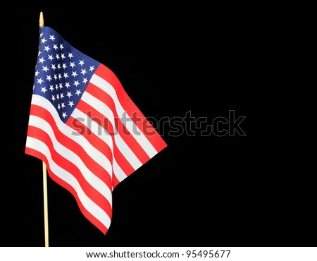 Ripples in US Flag isolated on black background with room for your text