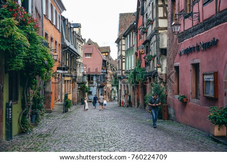 RIQUEWIHR, FRANCE - July 11, 2017: Nice atmosphere center of colmar city village in summer season travel luxury europe vacation famous tourist attraction, Riquewihr Alsace, France #760224709