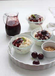 Risalamande, the Danish dessert is a rice pudding with vanilla, almonds and whipped cream, and it's typically served together with warm cherry sauce.