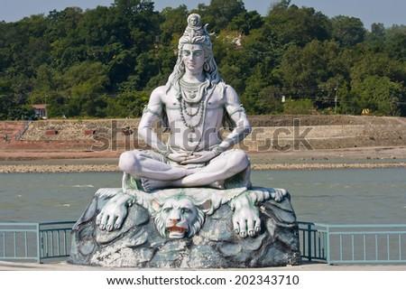 RISHIKESH INDIA-OCTOBER 24 2012 Statue Shiva hindu idol on the river Ganges