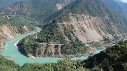 Rishikesh Valley on the Ganges river, India. River Ganga Flowing through Hrishikesh , Uttarakhand , India