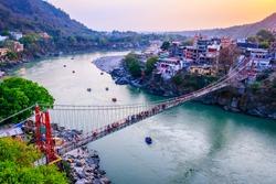 Rishikesh, yoga city India, Ganges River Ganga Ram Jhoola (Bridge).People enjoying rafting