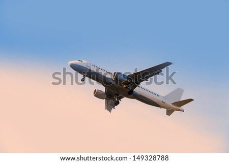 rising airplane in blue violet sky