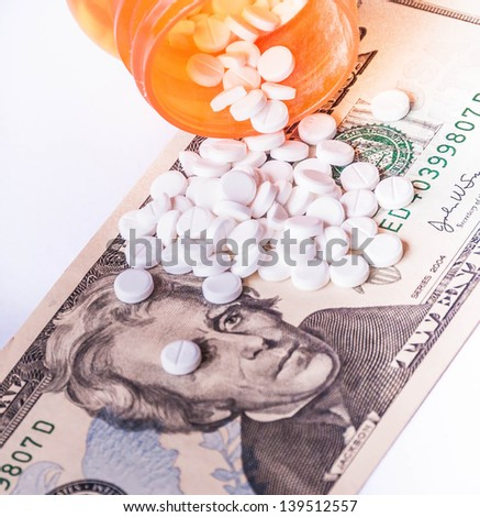 Rising cost of health care with spilled medicine. Drug abuse. Addiction.