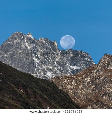 Rising full moon over the mountains near Lukla - Nepal