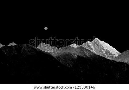 Rising full moon over the mountains near Lukla - Nepal (black and white)