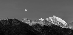 Rising full moon over the mountains near Lukla - Nepal, Himalayas (black and whitw)