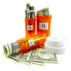 Rising health care costs.  Conceptual abstract photograph using one dollar bills and orange prescription bottles.