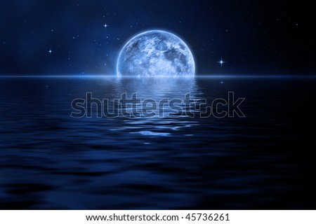 Rising moon over sea