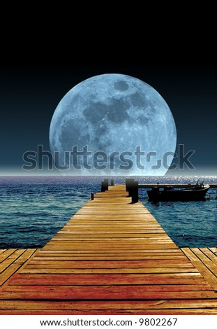 rising moon over the ocean