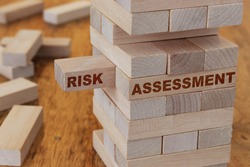 Risk assessment concept using wooden blocks