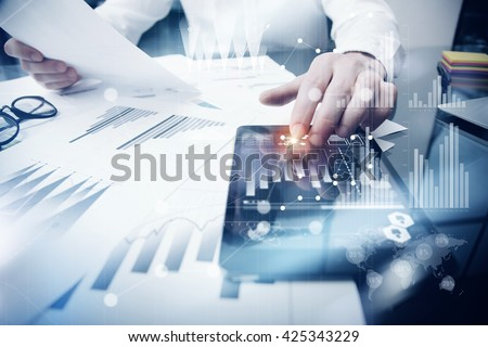 Risk Management Work process.Photo Trader working Market Report Documents Touching Screen Tablet.Using Graphic Icons,Stock Exchanges Reports. Business Project Startup. Horizontal, Flares Effect. Stockfoto ©