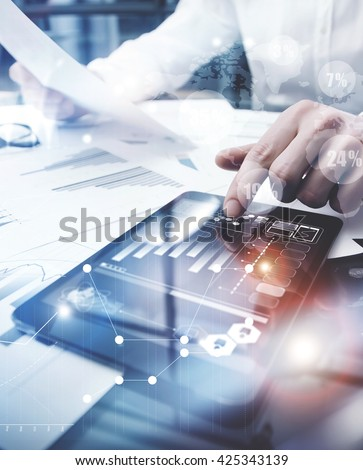 Risk Management Work process.Picture Trader working Market Report Document Touching Screen Tablet.Using Worldwide Graphic Icons,Stock Exchanges Reports.Business Project Startup. Vertical,Flares Effect