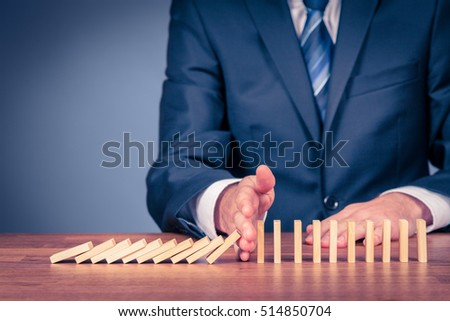 Risk manager stop domino effect. Risk management and insurance concept, leadership has solution for a problem.