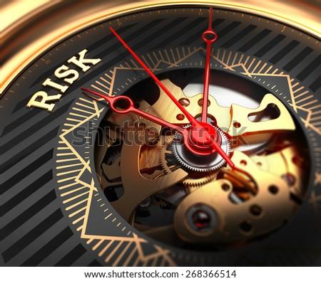 Risk on Black-Golden Watch Face with Watch Mechanism. Full Frame Closeup.