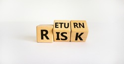 Risk or return symbol. Turned wooden cubes and changed the word 'risk' to 'return'. Beautiful white background. Risk or return and business concept. Copy space.
