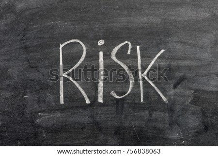 Risk written on chalkboard #756838063