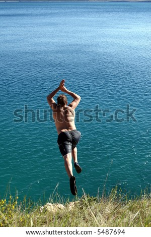 Riskin' It A young man jumps from a cliff into the sea!