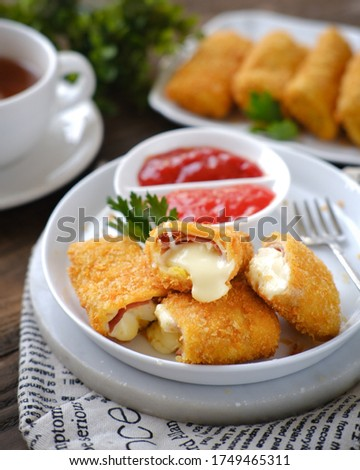 Risoles sosis mayo mozzarella is a small patty enclosed in pastry or rolled in bread crumbs. it is filled with smoked beef, mayonnaise, boiled egg and mozzarella cheese. (selective focus)