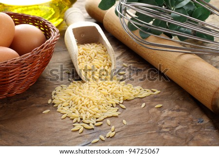 Risoni raw pasta on complex background