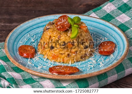 Risotto chorizo parmesan blue plate Stock fotó ©