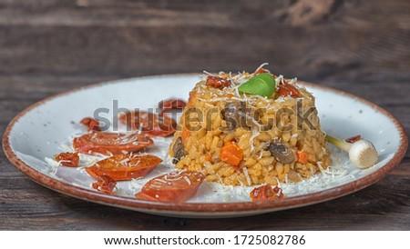 Risotto chorizo parmesan blue plate wood Stock fotó ©