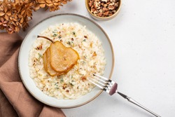 Risotto with gorgonzola cheese, pear and walnuts. Top view.