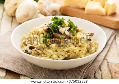 Shutterstock risotto with mushrooms, fresh herbs and parmesan cheese.