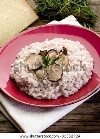 risotto with truffle over red dish