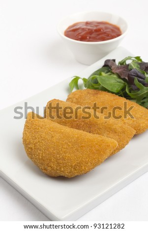 Rissole - Chicken and cheese rissole served with salad and chili sauce.