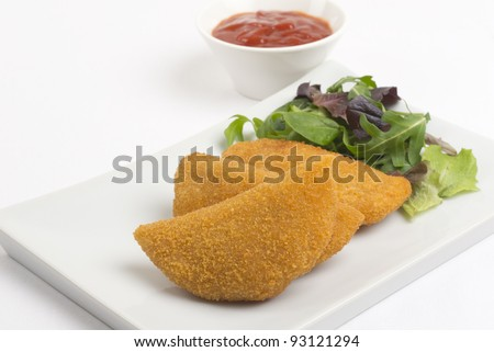 Rissole - Chicken and cheese rissole served with salad and chili sauce. - stock photo