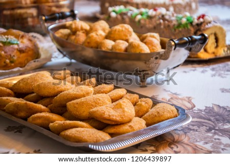 Rissoles on silver platter on a festive table. Is a snack, a type of crayon in a crescent shape made. #1206439897