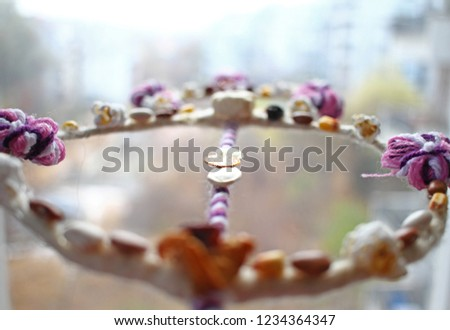 Ritual is pats the back of others with a survachka during Christmas day, wishing well for the New year. Survachka is from cornel, colored threads, yarn, wool, popcorns, peppers, apples, golden coin. #1234364347