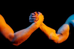 Rivalry, vs, challenge, strength comparison. Two men arm wrestling. Arms wrestling, competition. Rivalry concept - close up of male arm wrestling. Leadership concept