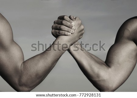 Rivalry, vs, challenge, strength comparison. Two men arm wrestling. Arms wrestling, competition. Rivalry concept - close up of male arm wrestling. Leadership concept. Black and white.