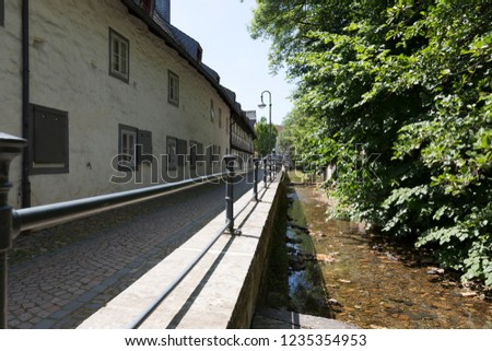 River Abzucht flowing through the center of Goslar, Germany