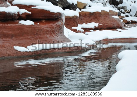 River after a spring blizzard in Sedona, Arizona