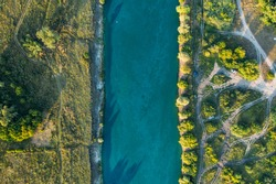 River among green forest in summer day, aerial top view.