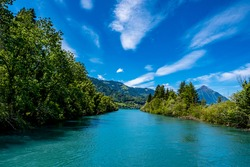 River and mountains with blue sky - Interlaken, Switzerland