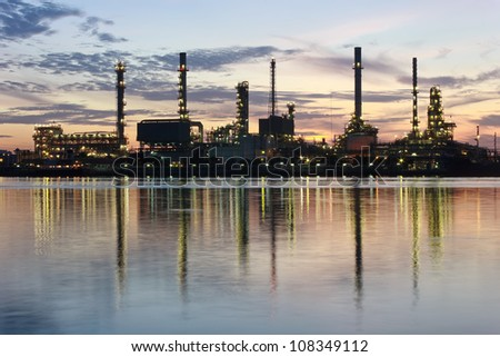 River and oil refinery factory with reflection in Bangkok, Thailand.