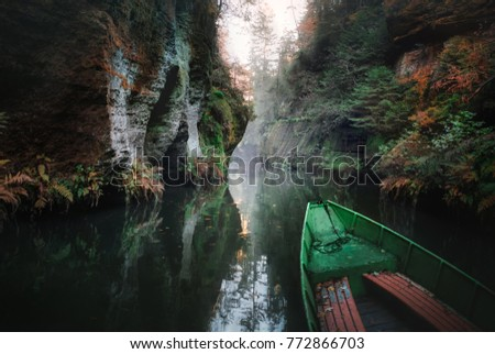River and rocks. photo of nature, landscape in autumn. boat in the park Czech switzerland