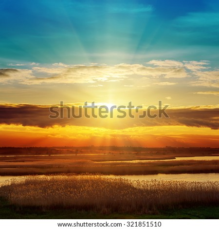 river and sunset in clouds