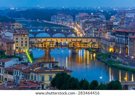 River Arno and famous bridge Ponte Vecchio at twilight from Piazzale Michelangelo in Florence, Tuscany, Italy