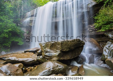 river background with small waterfalls in tropical forest.  #339658949