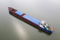 River barge for transportation of goods, top view, Aerial photo of barge, his flat-bottomed boat is mainly built for river and canal transport of heavy goods