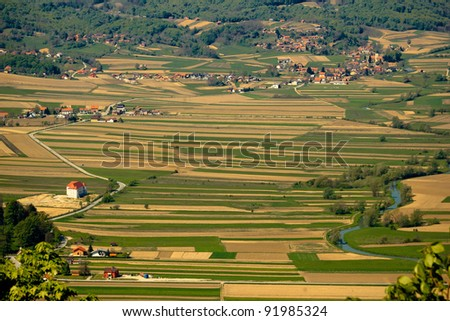 """River Bednja valley aerial view with castle """"Bela"""" and golden fields, Zagorje, Croatia"""