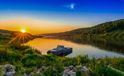 River boat at yellow sunset